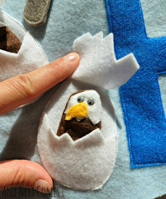 Close up of eagle finger puppet on letter E quiet book page from And Next Comes L