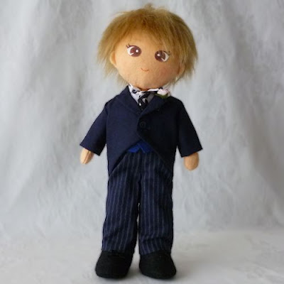 Boy doll in morning coat