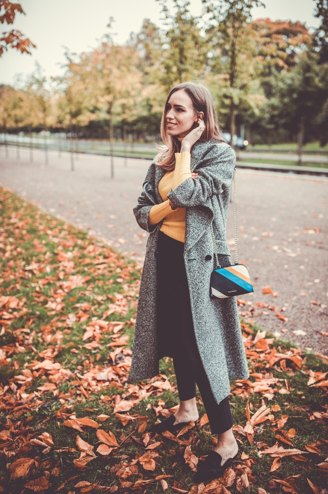 grey coat black trousers minimalist outfit