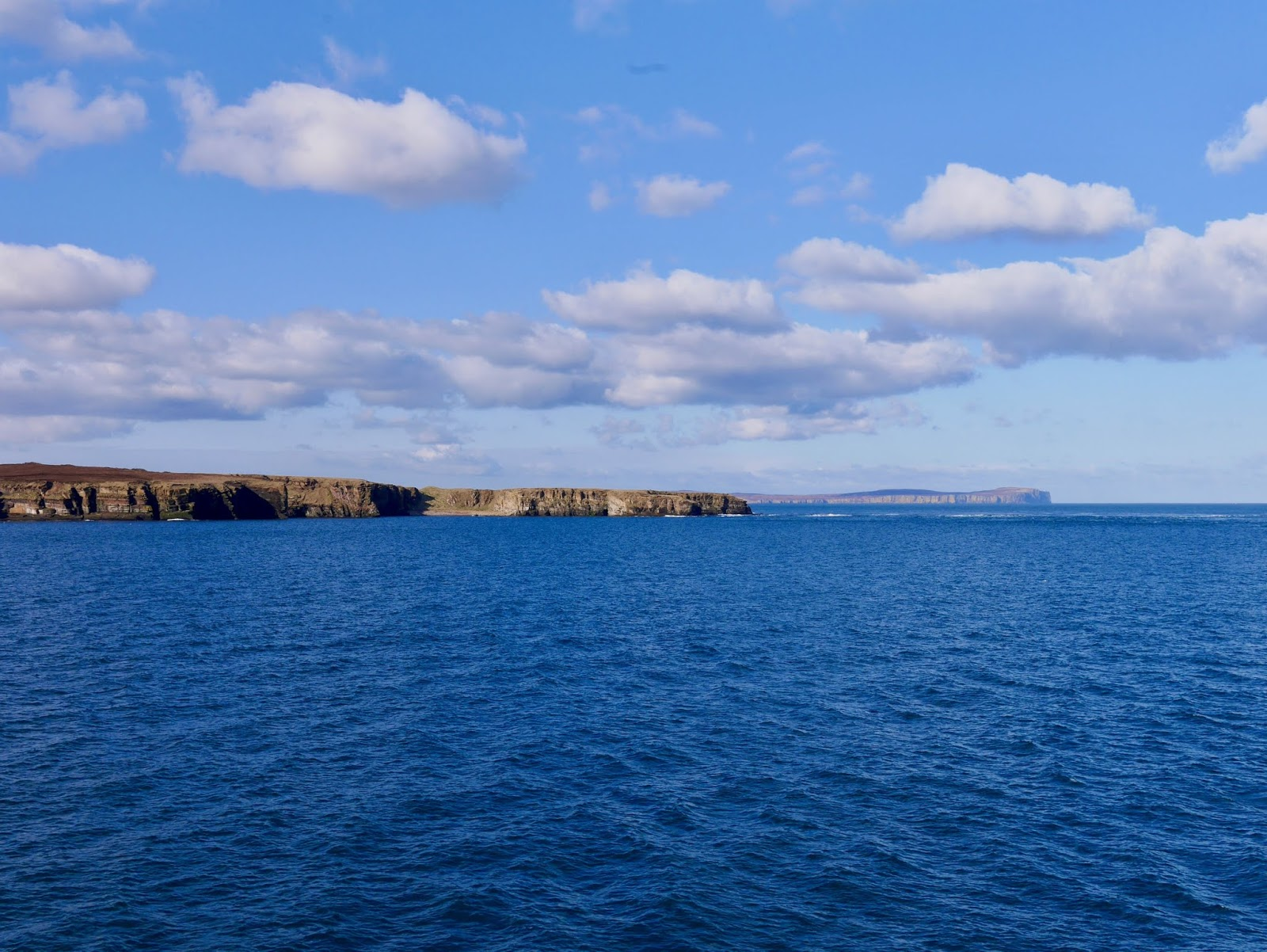 View of Dunnet Head from the boat to orkney, A trip to Orkney by www.CalMcTravels.com, Orkney, Whisky, Beer, Gin
