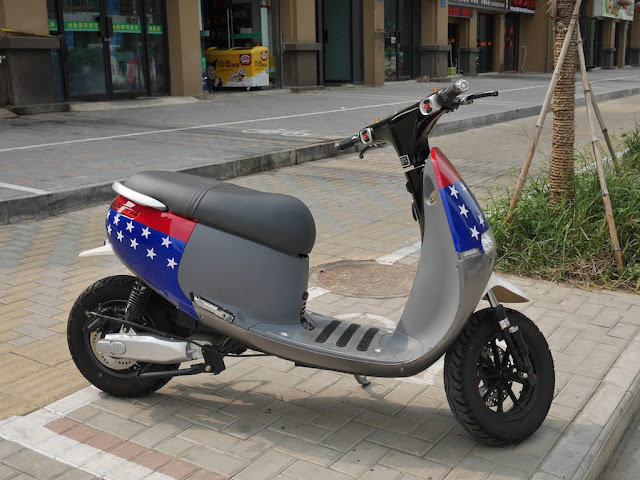 motor scooter with red, blue, and white stars