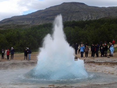 Strokkur, Iceland's old faithful geysir, at the start of its eruption