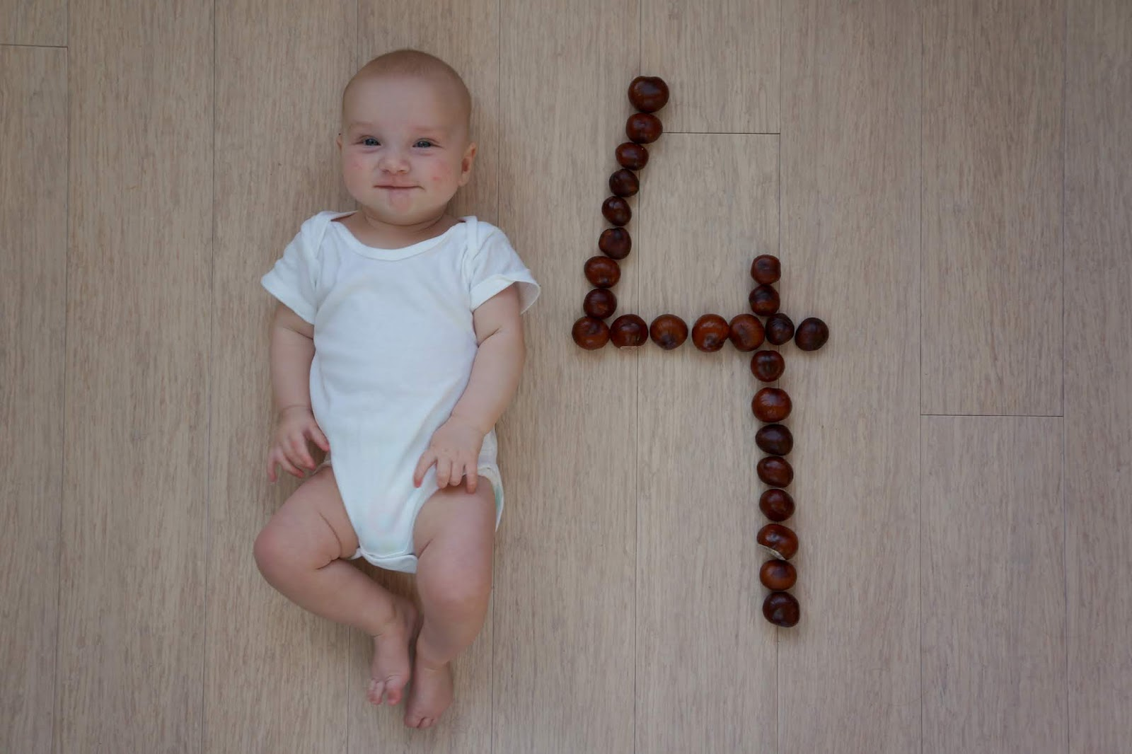 baby with number four made out of conkers