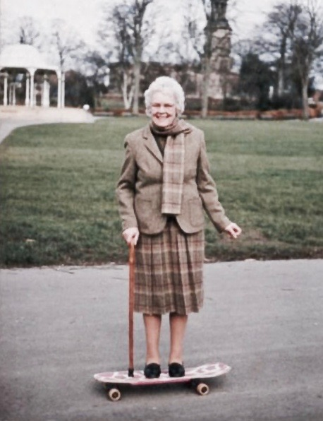 Snapshot grandma in tweed and a cane, standing on a skateboard. 1980s. Good Heavens and Other stories of Matronly Women. marchmatron.com