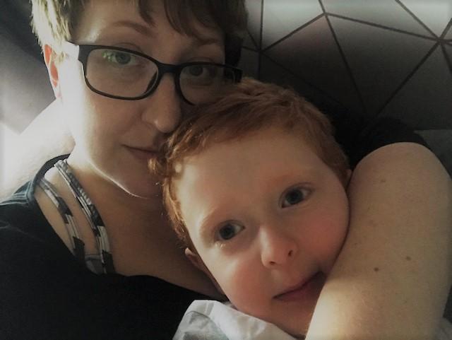 Mummy and little boy cuddling