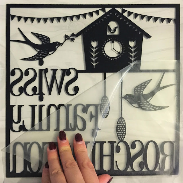 Removing transfer tape from vinyl.  Applying vinyl to glass tutorial by Nadine Muir for UK Silhouette Blog