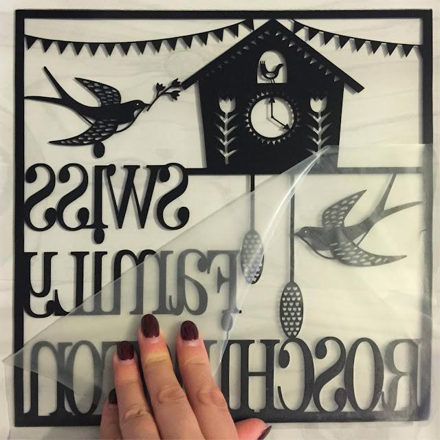 Removing transfer tape from vinyl.  Applying vinyl to glass tutorial by Nadine Muir for UK Silhouette Blog
