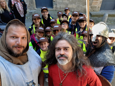 Jean-Francois Vassal teaching a class of school children about medieval times in Carcassone