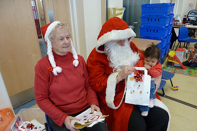Baby meeting Father Christmas