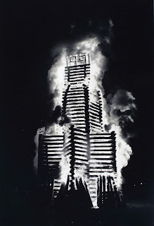 A black and white photograph of a bonfire.