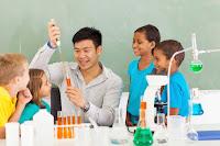 chemistry teacher teaching kids