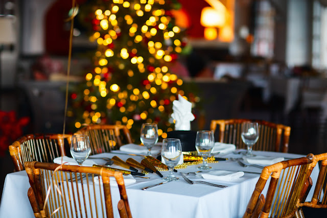 Christmas dinner table set in Iceland with Christmas tree in background