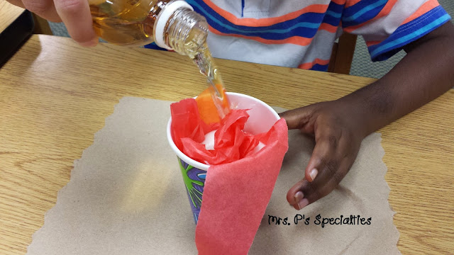 photo of student pouring apple cider into the cup