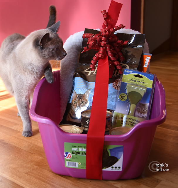 Maxie gives the Great Plains SPCA gift bundle his sniff of approval