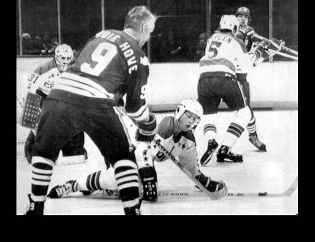 Vs. Hartford: Gordie Howe, age 52, returned to the NHL for the 1979-80 season with the Whalers. It took 'Mr. Hockey' just 8 minutes to score in a 3-3 tie. Here, Robert Picard dives between Howe and goalie Gary Inness. (12/4/79)