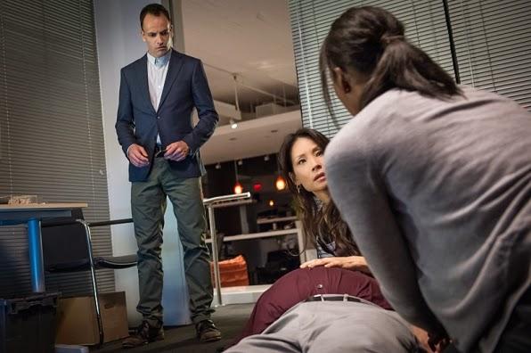 Sherlock Holmes Joan Watson investigating a corpse in CBS Elementary Season 3 Episode 4 Bella