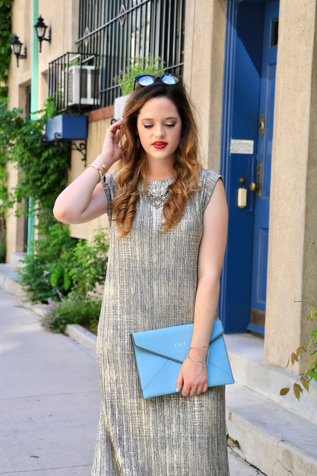 NYC fashion blogger wearing a gold dress styled for summer