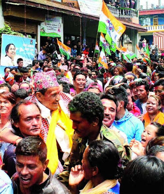 Trinamul supporters lift LB Rai after his victory from a ward in Mirik