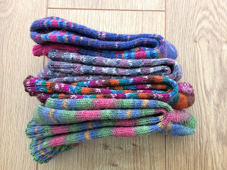 Stack of hand knit socks