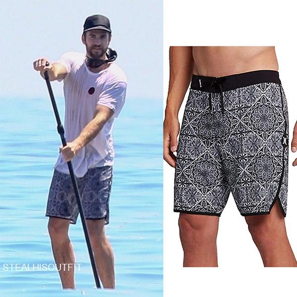 Liam Hemsworth in black printed board shorts mens summer fashion 2018