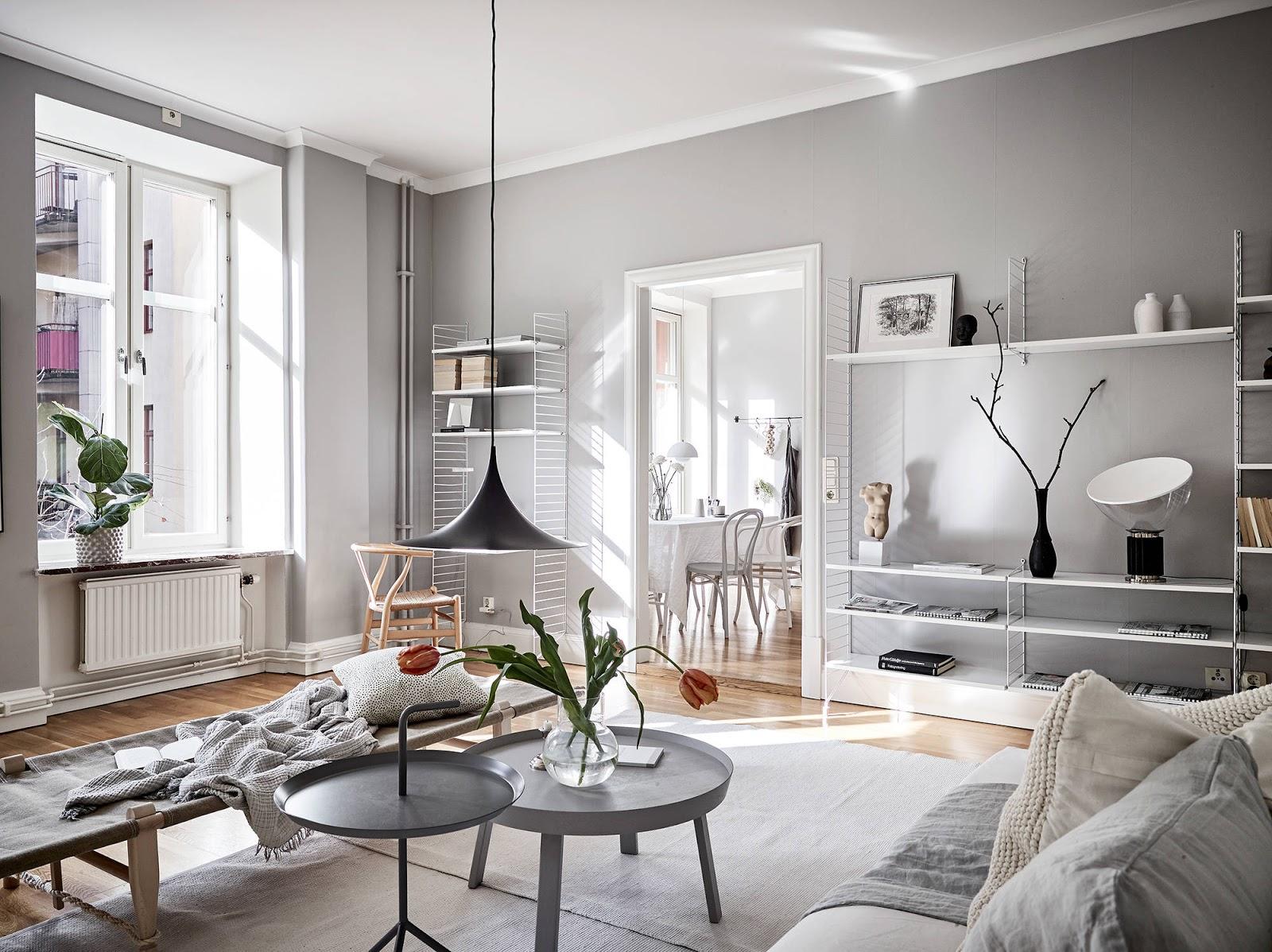 Appartamento con pareti grigie e arredi bianchi arc art - Pareti grigie soggiorno ...