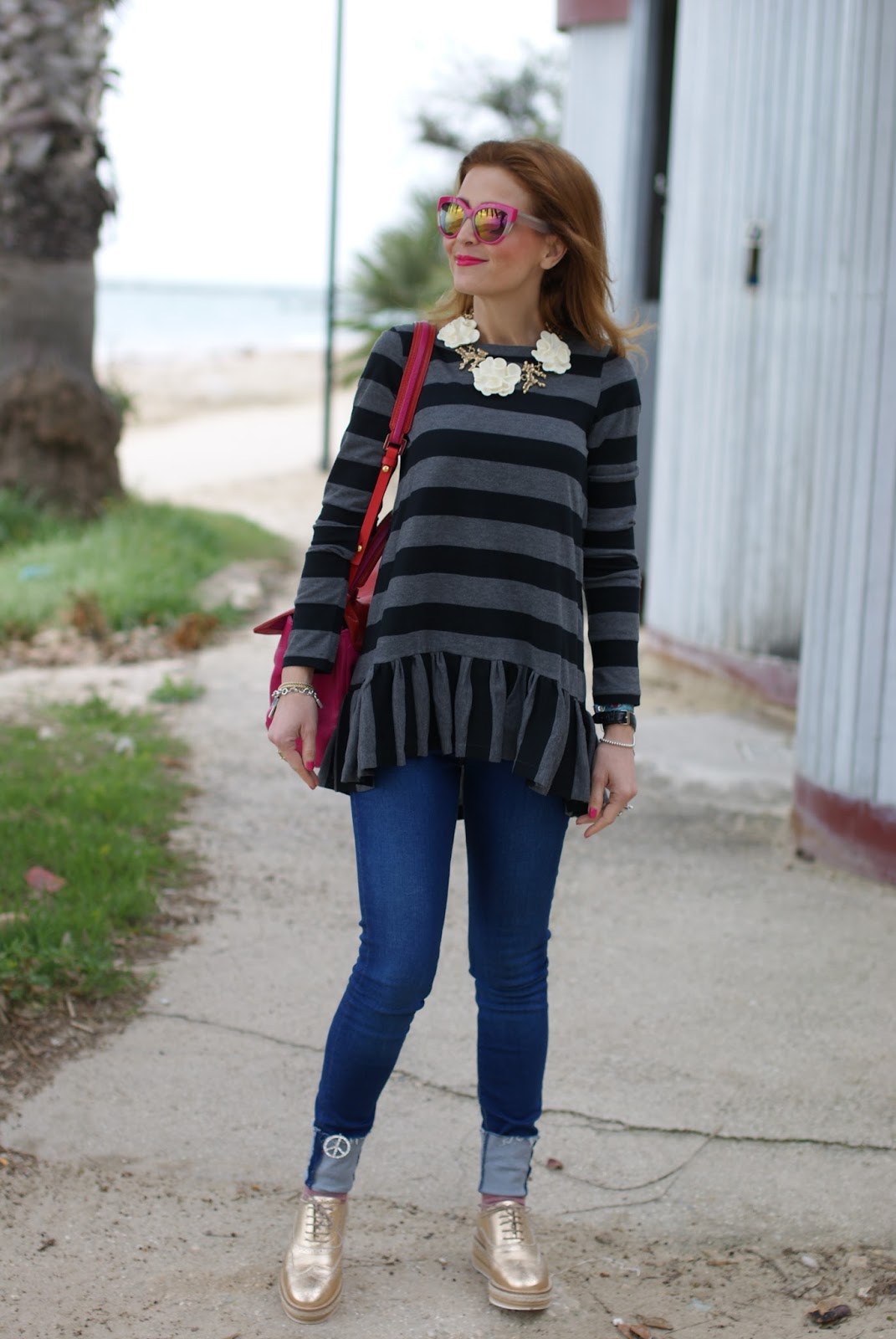 Stripes and ruffles outfit with Lorenzo Mari golden brogues on Fashion and Cookies fashion blog, fashion blogger style