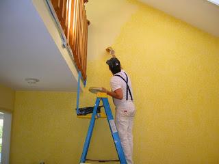Aplicación de pintura en hogares