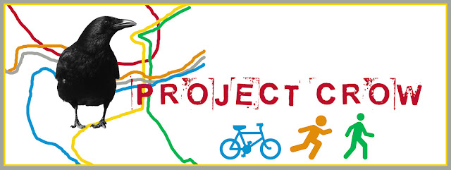 "masthead reading ""project crow"" There is a crow with lines representing a metro map behind him and also icons of a bike, runner, and walker"