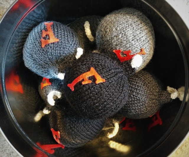 knitted F bombs using stashed yarn scraps