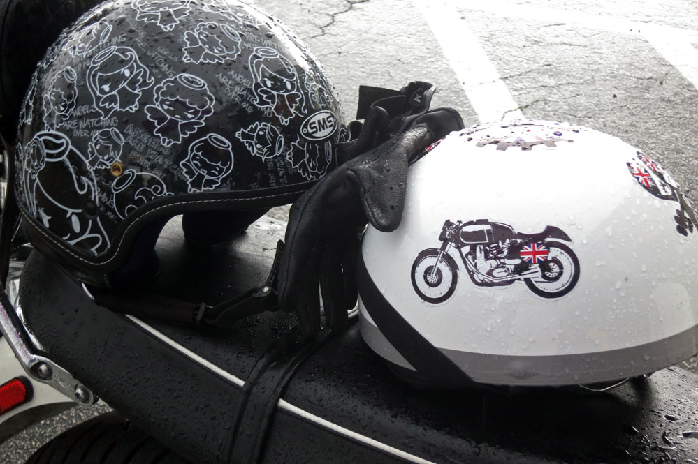 Helmets and gloves resting on motorcycle.