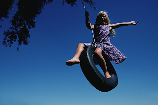 Image result for kid on tire swing images
