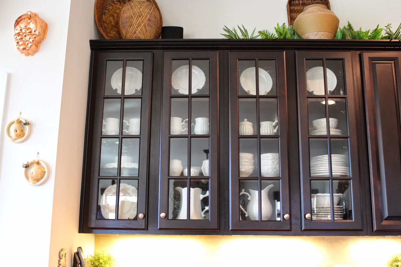 put all white dishes in the glass front cabinets. I love the look