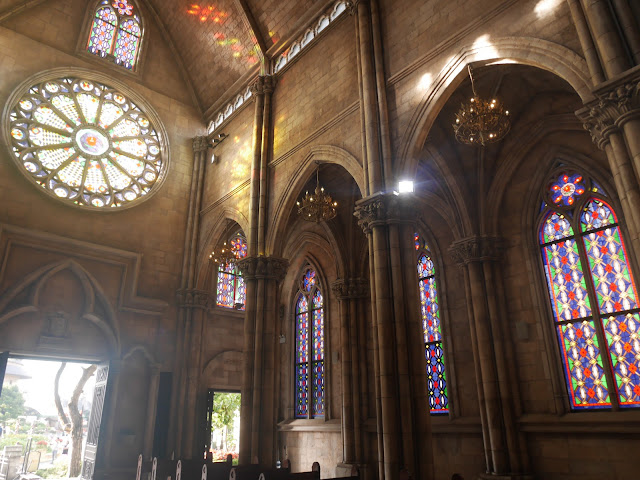 beautiful stained glass windows inside the church at the French Village on Ba Na Hills