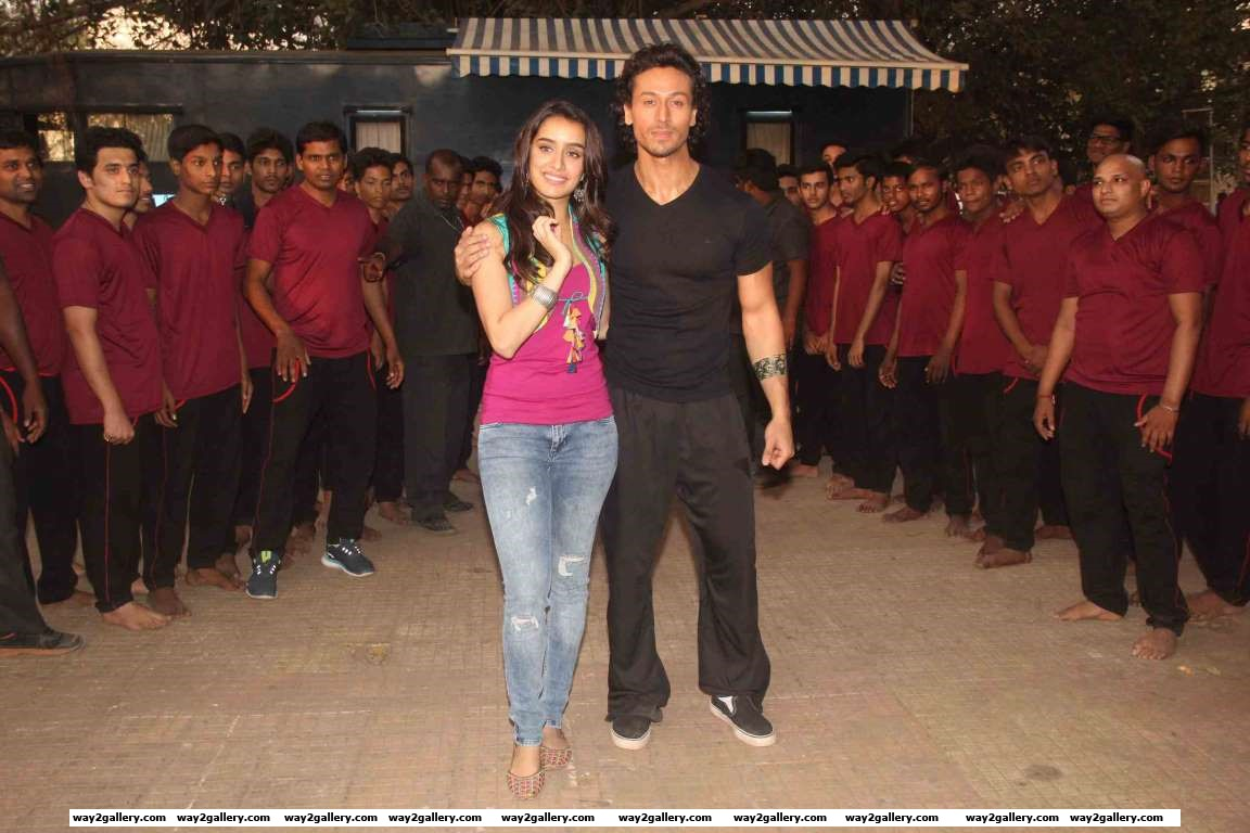 Tiger Shroff and Shraddha Kapoor pose for photographers on the set of Baaghi