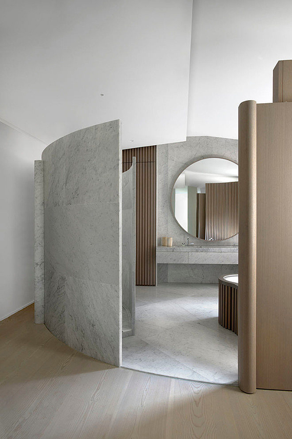 Eclectic bathroom design with marble and oak by François Champsaur in a Parisian apartment