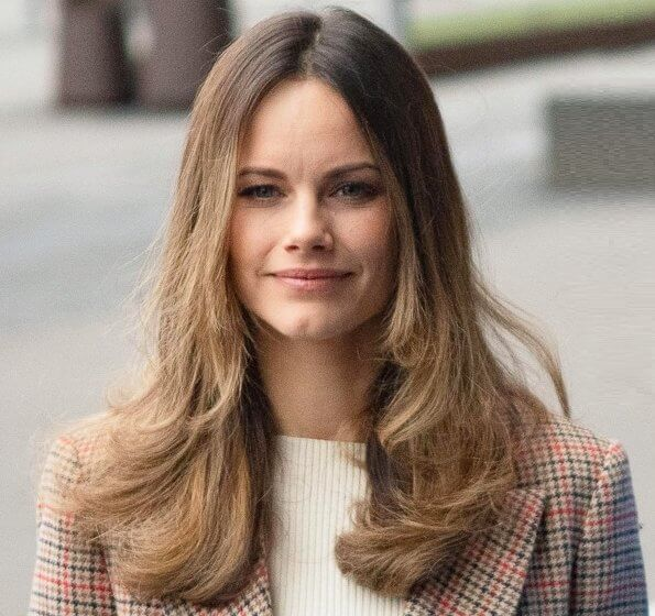 Princess Sofia wore a long checked duster coat by 2ndDay. camel bag and pants. Tommy Hilfiger claret red velvet jacket