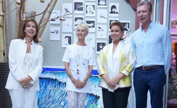Grand Duchess Maria Teresa wore a silk kimono-style jacket by Anelore. The royal couple visited french designer Anelor's fashion show in Biarritz
