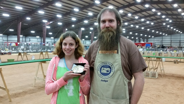Showing off her Showman Champion belt buckle