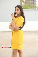 Actress Poojitha Stills in Yellow Short Dress at Darshakudu Movie Teaser Launch .COM 0062.JPG