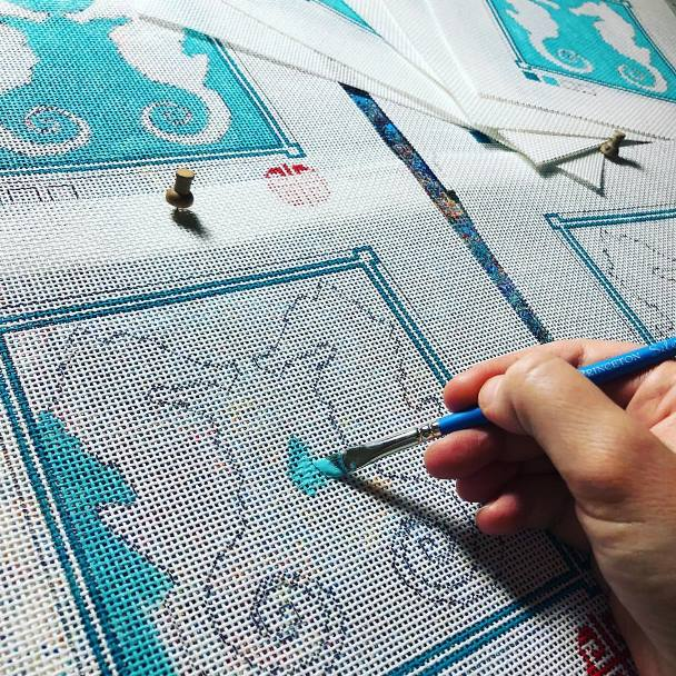 Jenny Henry Designs handpainting seahorse design onto needlepoint canvas