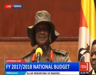 Ugandan President Museveni shows off the hat he designed.
