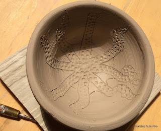 Clay pot with carved octopus