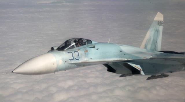 Pesawat Sukhoi SU-27 Cegat Pesawat Pengintai Amerika Serikat