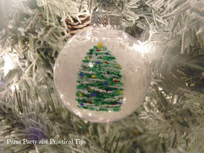 a picture of the finished painted Christmas tree ornament