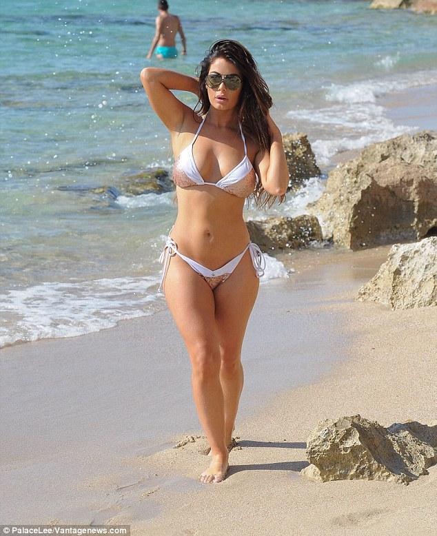 Jess Hayes in skimpy white and gold bikini