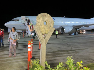 Stone money at Yap Airport.