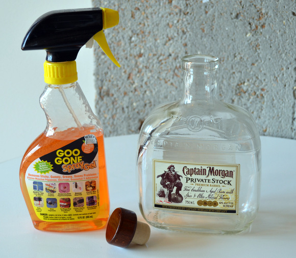To begin making your soap dispenser, empty the alcohol into another container and use Goo Gone to remove the label.