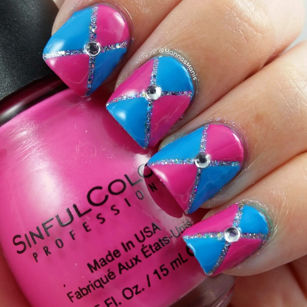 purple and blue nail polish with glitter nail polish and rhinestones