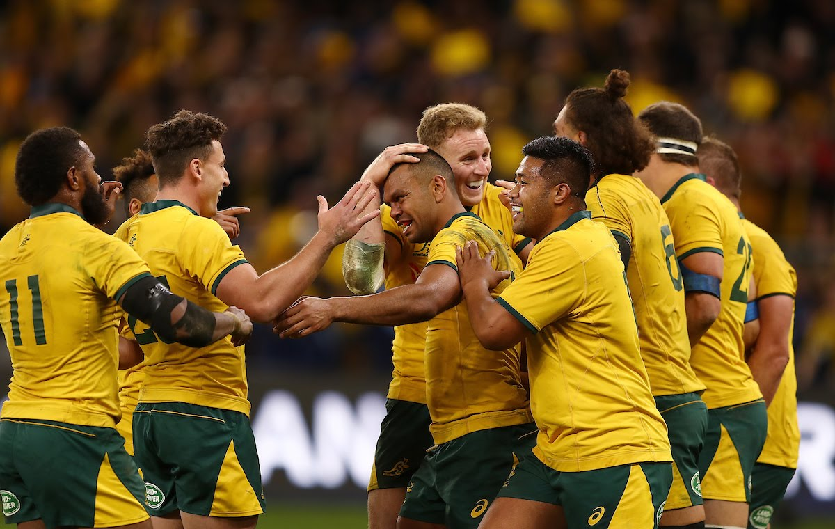 Australia players celebrate after Kurtley Beale