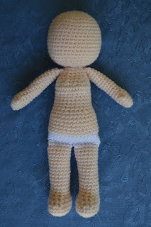 Body of the doll before adding face and hair.  The stitches are flesh coloured except for white stitches for the underpants.